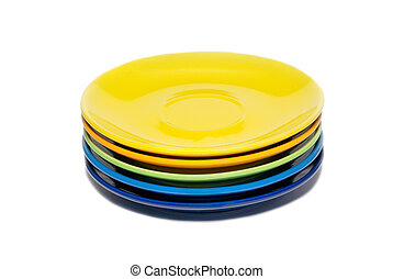 Stack of colored ceramic saucer isolated on white.