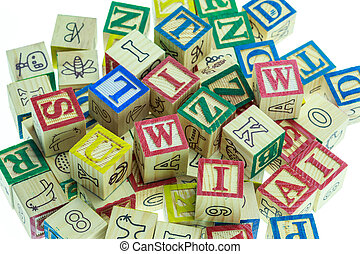 Stack of colorful alphabet blocks isolated on white