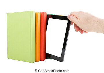 Stack of colorful books and electronic book reader. Electronic library concept. Back to school. Copy space