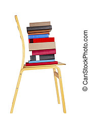 Stack of colorful books on brown wooden chair.