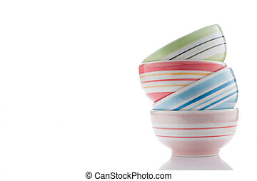 stack of colorful bowls on white
