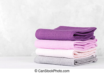 Stack of colorful cotton kitchen towels