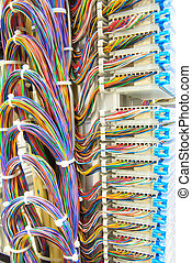 stack of colorful electronic wire in socket board of ditigal tel