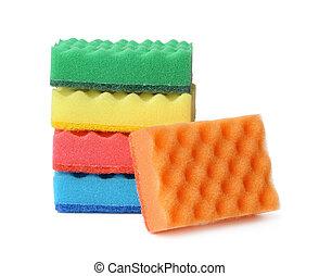 Stack of colorful plasdtic dishwashing sponges