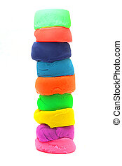 stack of colorful plasticine isolated on white