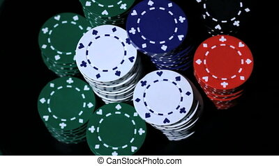 Stack of colorful poker chips.