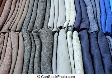 Stack of colorful t-shirts for sale