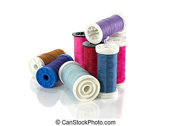 stack of coloured sewing thread