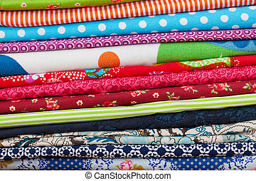 Stack of colourful folded fabric