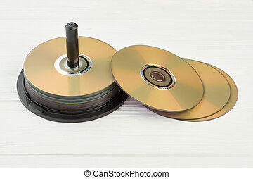 Stack of compact discs on white background.