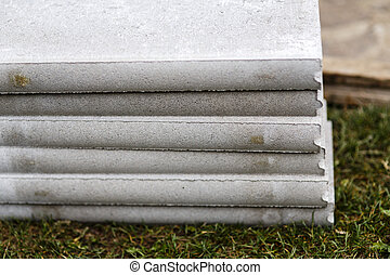 stack of concrete curb on the grass