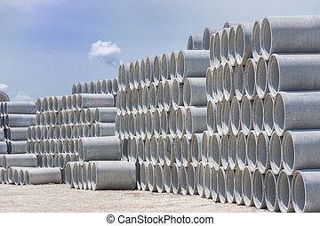 Stack of concrete drainage pipes for wells and water discharges & Large concrete pipes waiting for infrastructure work.