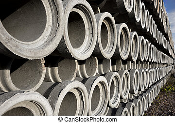 Stack of concrete drainage pipes with diminishing...