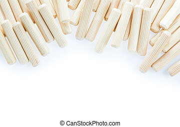 Stack of construction wooden dowels isolated on white