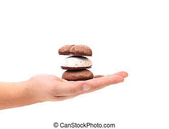 Stack of cookies in hand.