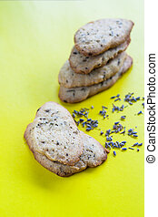 stack of cookies with lavender on a yellow background