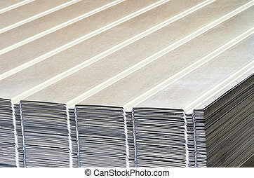 Stack of corrugated steel sheet  in a warehouse