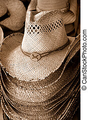 Stack of cowboy hats in sepia for sale