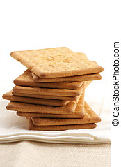 Stack of crackers - Stack of square crackers on beige linen...