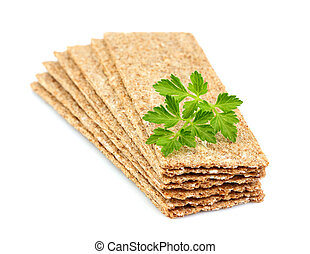 Stack of crispbread with fresh parsley.