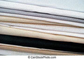 Stack of cross stitch fabrics