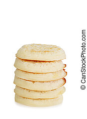 stack of crumpets on white