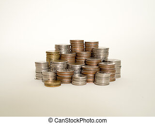 Stack of different coins isolated on white background.