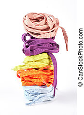 Stack of different colors shoe laces. Five round strings for...