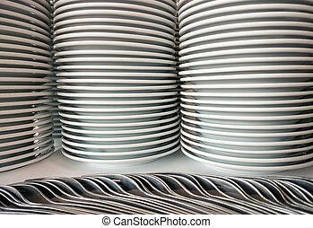 Stack of dinner plates with cutlery