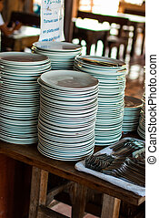stack of dishes for the buffet in the morning on Koh Nang...