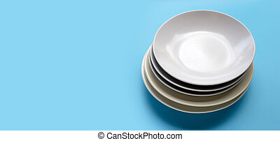 Stack of dishes on blue background.