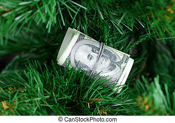 stack of dollars on the Christmas tree