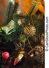 Stack of dollars under the Christmas fir