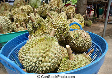 stack of durian fruit for sale