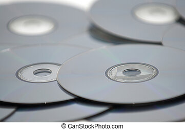 stack of DVDs, CDs, or Blu-Rays