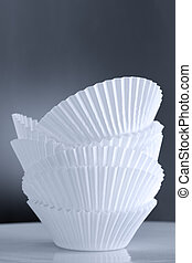 Stack of Empty Cupcake Cases over Toned Background