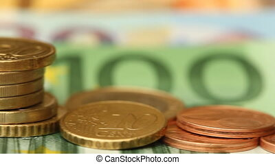 Stack of Euro coins on banknotes
