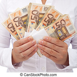 Stack of euros in woman hands