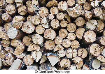 Stack of firewood logs close-up