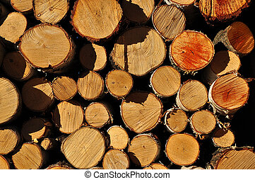 Stack of firewood - Background of stacked chopped wood...