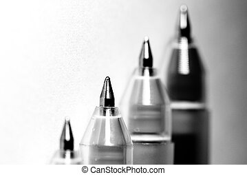 stack of four ballpoint pen in black and white