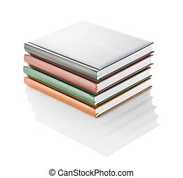 stack of four diaries isolated
