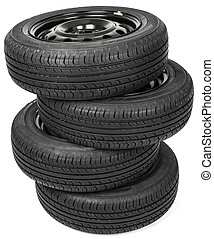 Stack of four wheel black tyres for summer