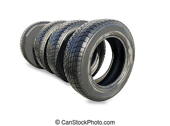 Stack of four wheel new black winter tyres for car