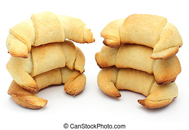 Stack of fresh croissants on white background