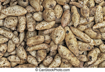 Stack of fresh potatoes, background close up