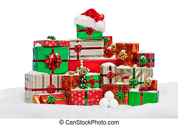 Stack of gift wrapped Christmas presents on snow - A stack...
