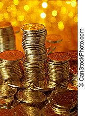 Stack of golden ukrainian coins