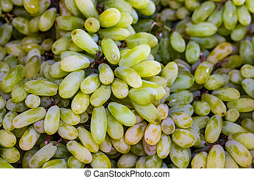 stack of grapes in retail vegetable super market for sale