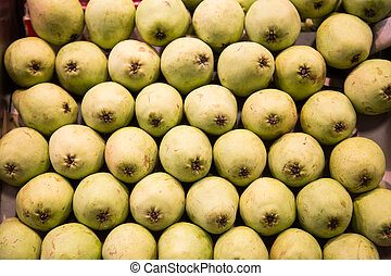 Stack of Green Pears in a Market